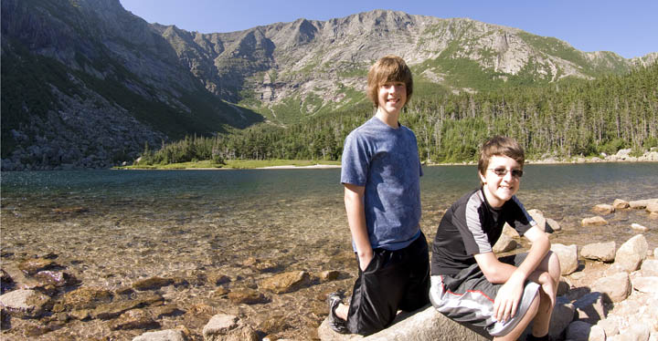 The boys at Chimney Pond, the tree line of the mountain.